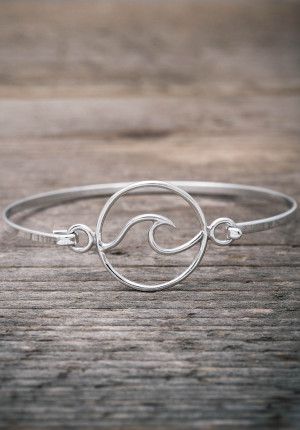 Silver bangle with a wave