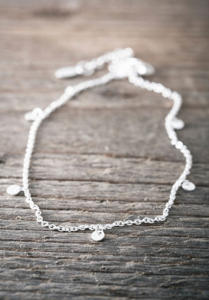 Silver anklet with dangling mini discs